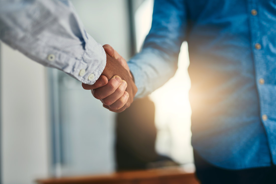 Handshake between business staff member and a client